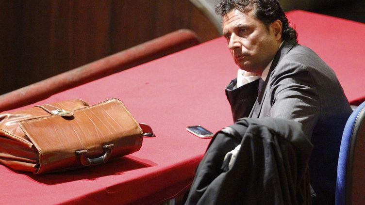 """Francesco Schettino, ancien commandant du """"Costa Concordia"""", assiste à son procès, le 17 juillet 2013, à Grosseto (Italie). (GIAMPIERO SPOSITO / REUTERS)"""