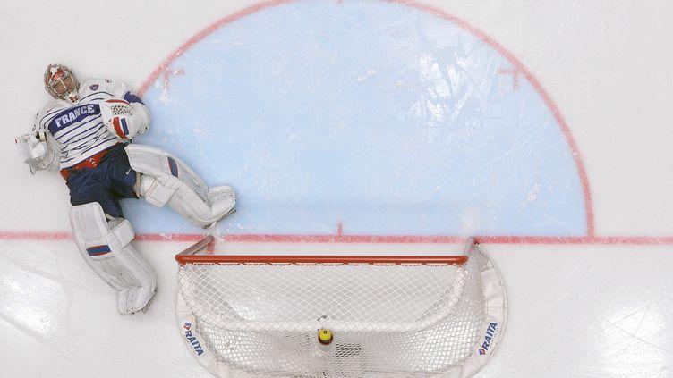 Cristobal Huet, gardien de l'équipe de France de hockey-sur-glace  (ALEXANDER NEMENOV / AFP)