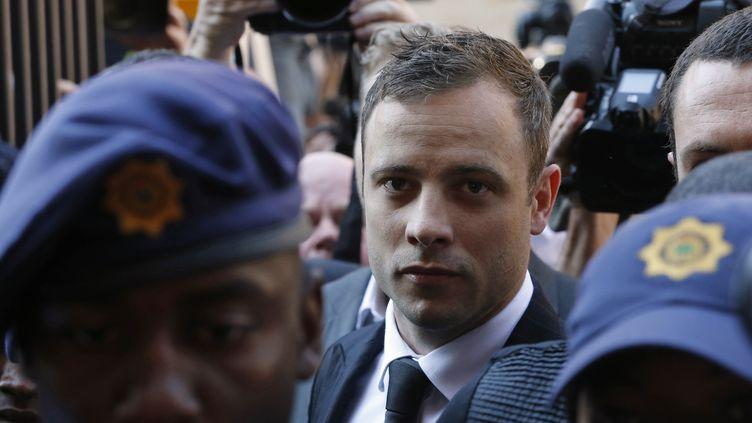 Le champion paralympique sud-africain Oscar Pistorius arrive au tribunal de Pretoria (Afrique du Sud) le 12 septembre 2014. (MIKE HUTCHINGS / REUTERS )