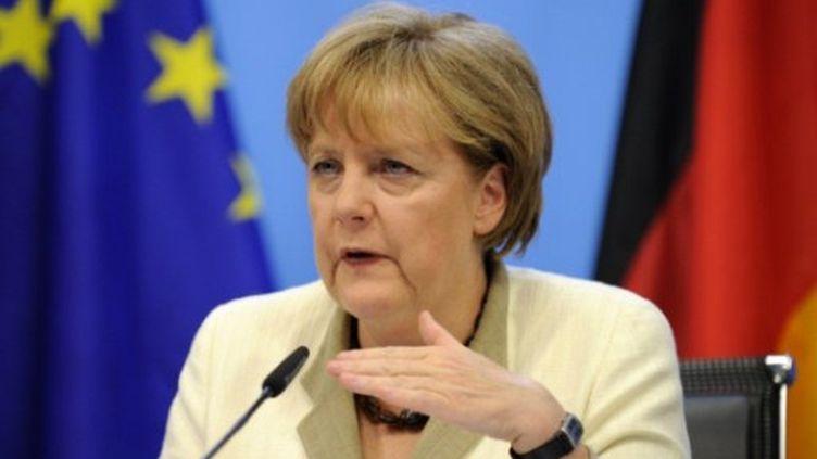 Angela Merkel est confrontée à ses électeurs qui sont majoritairement opposés au plan d'aide des pays de la zone euro. (AFP - John Thys)