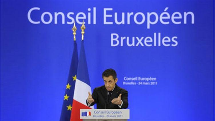 Le président Nicolas Sarkozy, au sommet européen de Bruxelles, le 25 mars 2011, justifie l'intervention en Libye. (AFP/LIONEL BONAVENTURE)