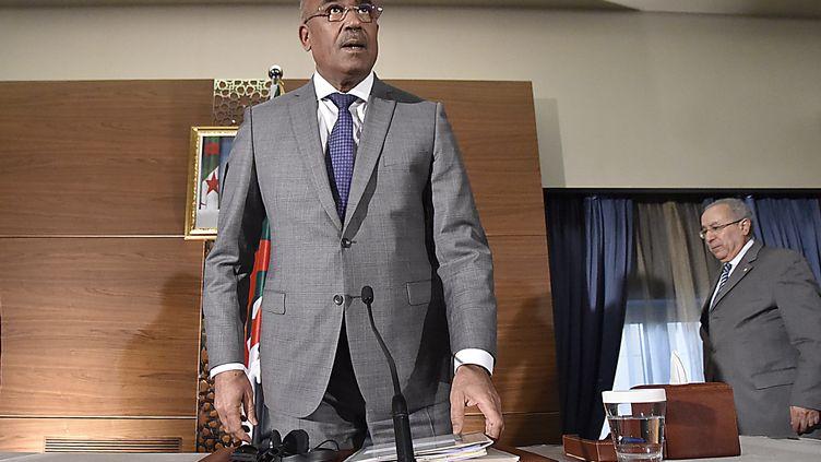 Le Premier ministreNoureddine Bedoui, lors d'une conférence de presse, le 14 mars 2019 à Alger. (RYAD KRAMDI / AFP)