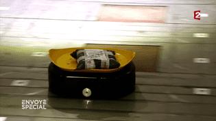 Robot dédié autri postal en Chine (FRANCE 2 / FRANCETV INFO)