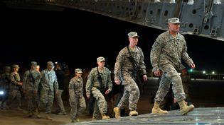 Des soldats américains quittent la camp Adder en Irak, le 17 décembre 2011. (MARTIN BUREAU / AFP)