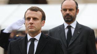 Emmanuel Macron et Edouard Philippe, à l'hôtel des Invalides, à Paris, le 28 mars 2018. (LUDOVIC MARIN / AFP)
