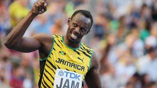 Usain Bolt triomphe en finale du relais 4x100 m aux Mondiaux d'athlétisme de Moscou (Russie), le 18 août 2013. (YURI KADOBNOV / AFP)