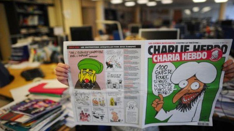 La une mettant en scène Mahomet. (MARTIN BUREAU / AFP)