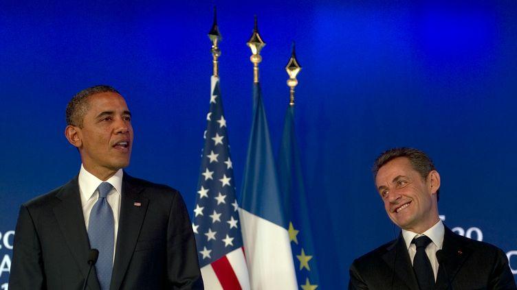 Le Président américain Barack Obama et son homologue français Nicolas Sarkozy, lors d'une conférence de presse commune jeudi 3 novembre à Cannes. (JIM WATSON / AFP)