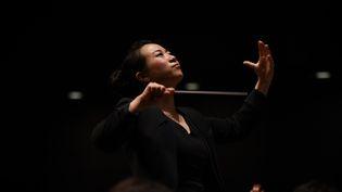 Jing Huan, cheffe de l'Orchestre symphonique de Canton.  (WANG Zhao / AFP)