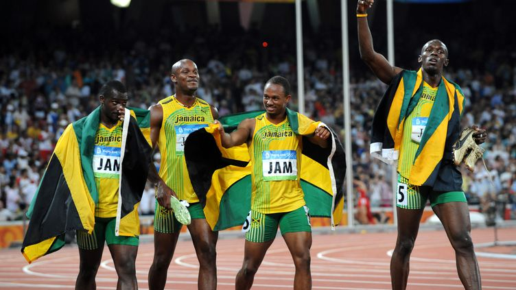 Le relais jamaïquain victorieux du 4X100m aux JO de Pékin 2008 (KARL-JOSEF HILDENBRAND / DPA)