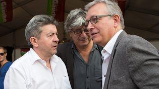 Jean-Luc Mélenchon (à gauche) en compagnie du secrétaire national du PCF, Pierre Laurent (à droite), le 11 septembre 2015 à la Fête de l'humanité à La Courneuve (Seine-Saint-Denis). (MAXPPP)