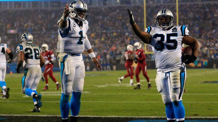 Les deux joueurs des Carolina Panthers, Cam Newton et Mike Tolbert