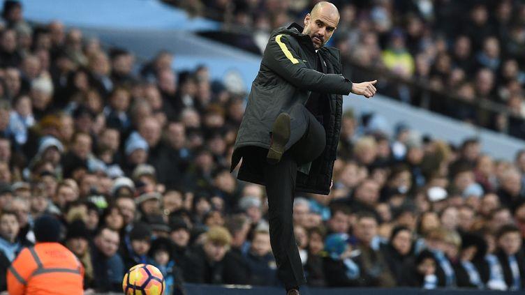 Pep Guardiola. (OLI SCARFF / AFP)