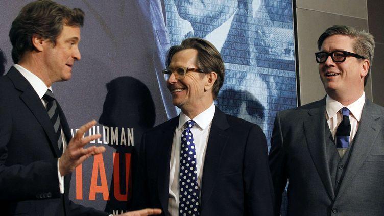 """Tomas Alfredson, Gary Oldman et Colin Firth lors de la première du film """"La Taupe"""" à Paris le 20 janvier 2012  (Christophe Ena/AP/SIPA)"""