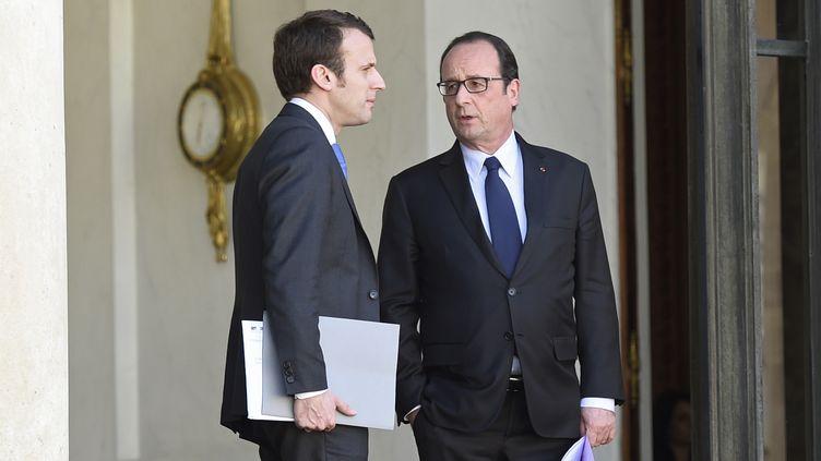 François Hollande et Emmanuel Macron, le 14 avril2015, à Paris. (ALAIN JOCARD / AFP)