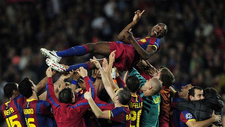 Revenu pour la demi-finale de C1 en mai 2011, Abidal porté en triomphe par ses coéquipiers du Barça (JOSEP LAGO / AFP)