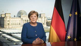 La chancelière allemande, Angela Merkel, donne une allocution télévisée depuis Berlin, le 18 mars 2020. (STEFFEN KUGLER / BUNDESREGIERUNG / AFP)
