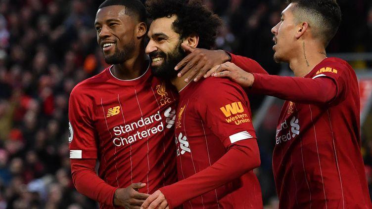 La joie de Wijnaldum, Salah et Firmino (Liverpool) (PAUL ELLIS / AFP)