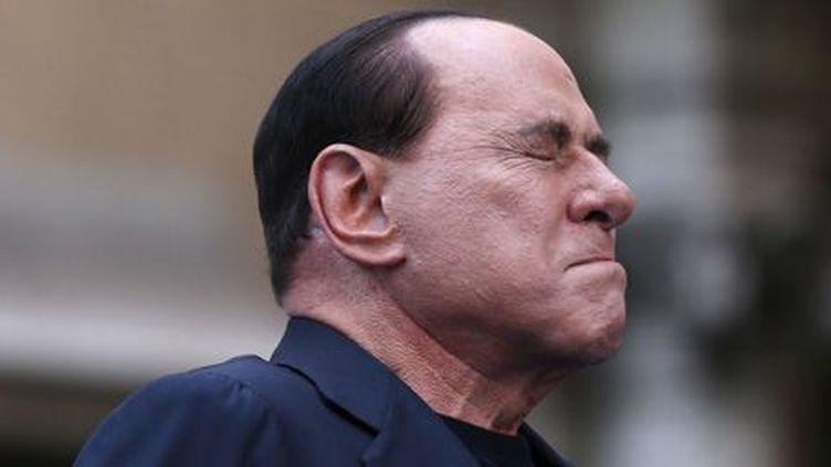 L'ancien président du Conseil italien Silvio Berlusconi pendant un meeting de protestation contre sa condamnation pour fraude fiscale, le 4-8-2013 à Rome. (Reuters - Alessandro Bianchi )