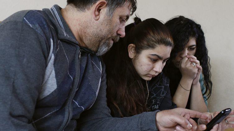 (Leonarda et sa famille en janvier 2014 au Kosovo © Maxppp)