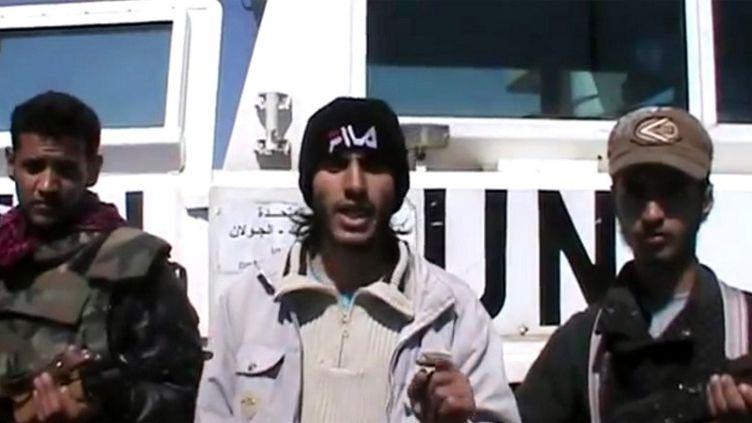 Des rebelles syriens ont détaillé leurs revendications dans une vidéo, aprèsl'enlèvement des 21 observateurs de l'ONU le 6 mars 2013 sur le plateau du Golan. (YOUTUBE / AFP)