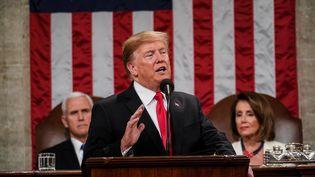 Le président des Etats-Unis Donald Trump pendant son discours sur l'état de l'Union, à Washington, le 5 février 2019. (DOUG MILLS / CONSOLIDATED NEWS PHOTOS / AFP)