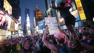Manifestation après l'acquittement de George Zimmerman, à Times Square (New-York,Etats-Unis), le 14 juillet 2013. (MARIO TAMA / GETTY IMAGES NORTH AMERICA)