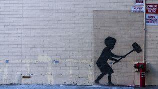Une peinture de Banksy à New York (24 octobre 2013)  (Till Jacket / Photononstop / AFP)