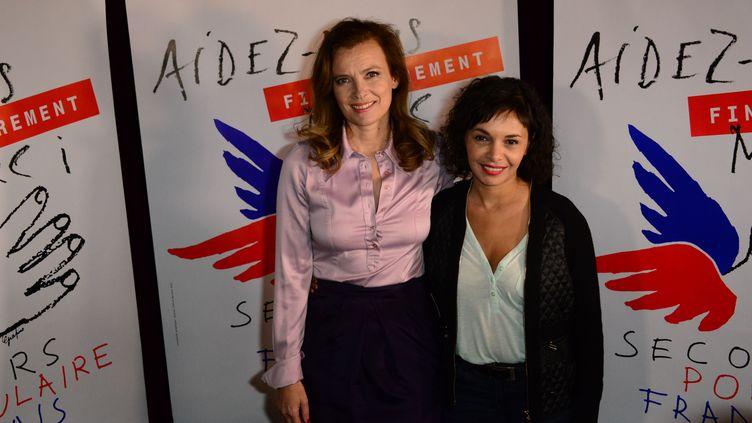 Valérie Trierweiler (G) et Saïda Jawad (D) au musée des Arts forains, à Paris, le 28 mars 2014. (LAURENT BENHAMOU / SIPA)