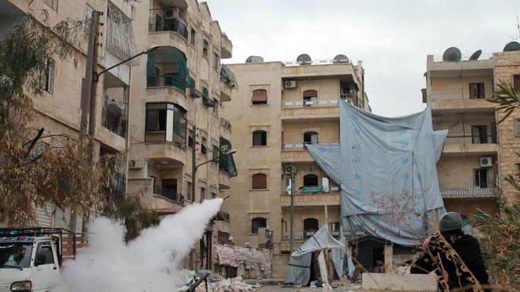 Des combats dans les rues d'Alep, en Syrie, dimanche 12 janvier 2014. (MAHMUD AL-HALABI / AFP)