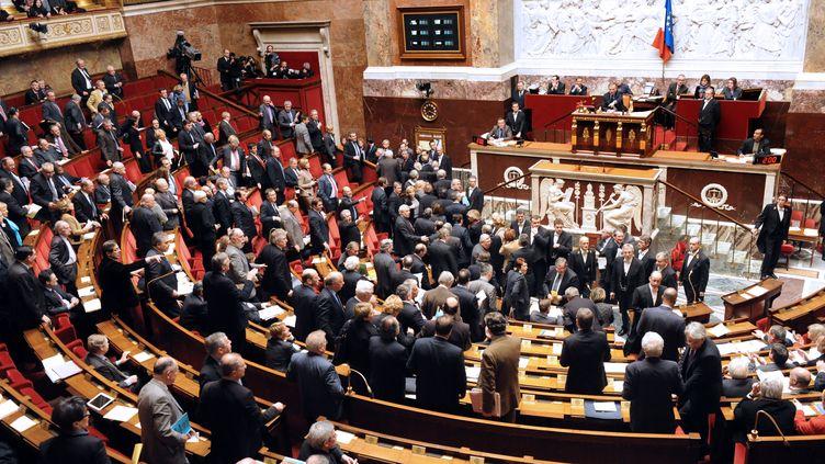 Les députés de la majorité quittent l'hémicycle avant le terme de la séance, le 7 février 2012. (MEHDI FEDOUACH / AFP PHOTO)