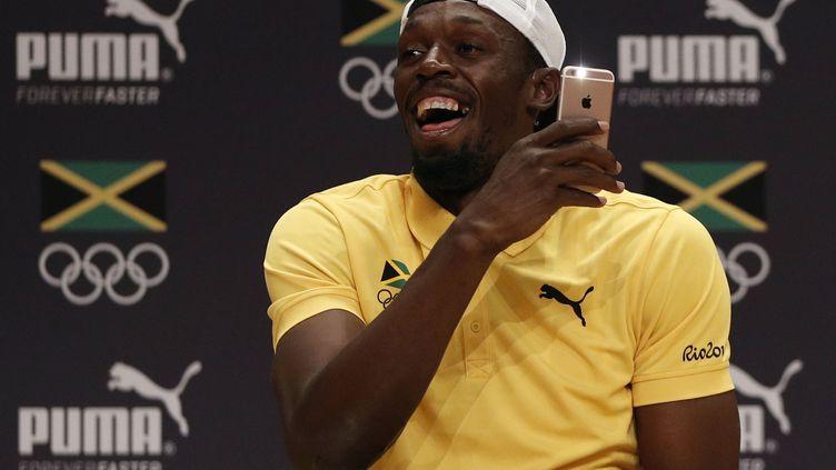 Usain Bolt lors de la conférence de presse jamaïcaine (ADRIAN DENNIS / AFP)