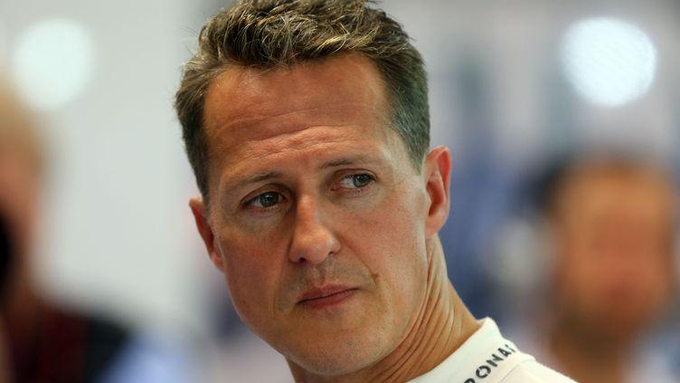 Le champion de Formule 1 Michael Schumacher à Singapour, le 23 septembre 2012. (JENS BUTTNER / DPA / AFP)