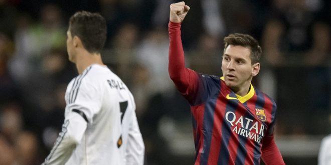 Lionel Messi et Cristiano Ronaldo lors d'un Clasico en 2014 (DANI POZO / AFP)