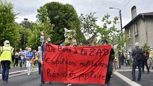 Manifestation à Bar-le-Duc (Meuse), le 16 juin 2018, contre le projet d'enfouissement des déchets nucléaires, à Bure. (JEAN-CHRISTOPHE VERHAEGEN / AFP)
