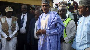 Le président du Nigeria, Muhammadu Buhari, s'apprête à voter dans sa ville natale de Daura, dans le nord-ouest du Nigeria, le 23 février 2019. (PIUS UTOMI EKPEI / AFP)