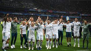La joie des joueurs madrilènes, vainqueurs de la Ligue des champions contre Liverpool (3-1), samedi 26 mai 2018 à Kiev (Ukraine). (FRANCK FIFE / AFP)