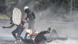 Une manifestation de l'opposition contre le président Nicolas Maduro, à Caracas (Venezuela), le 10 mai 2017. (JUAN BARRETO / AFP)