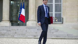 Manuel Valls quitte l'Elysée peu après sa nomination à Matignon il y a un an, le 4 avril 2014. (FRED DUFOUR / AFP)