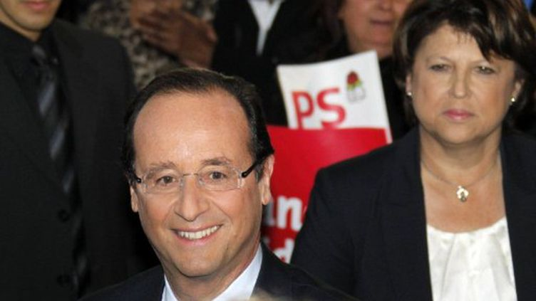 François Hollande, décontracté et souriant lors de son investiture officielle (AFP/JOEL SAGET)