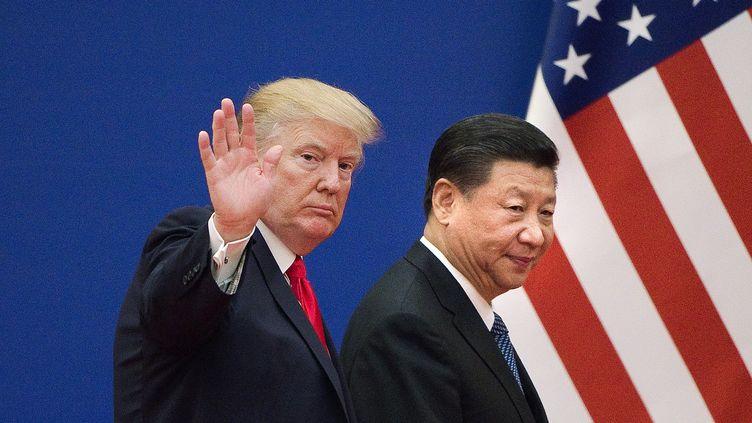 Donald Trump et le président chinois Xi Jinping, le 9 novembre 2017. (NICOLAS ASFOURI / AFP)