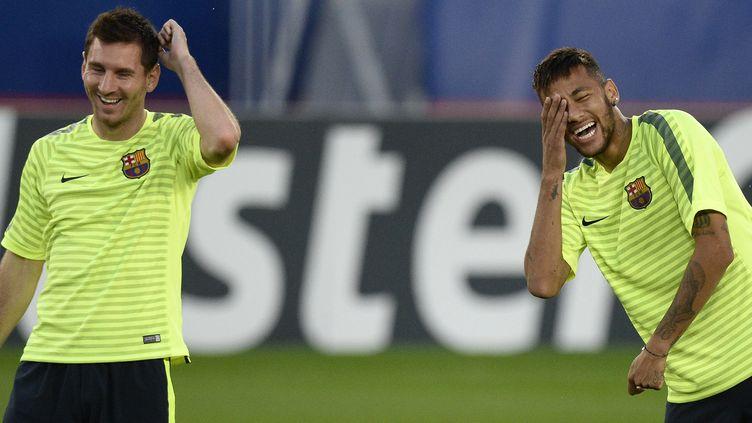 Messi et Neymar à l'entraînement (FRANCK FIFE / AFP)
