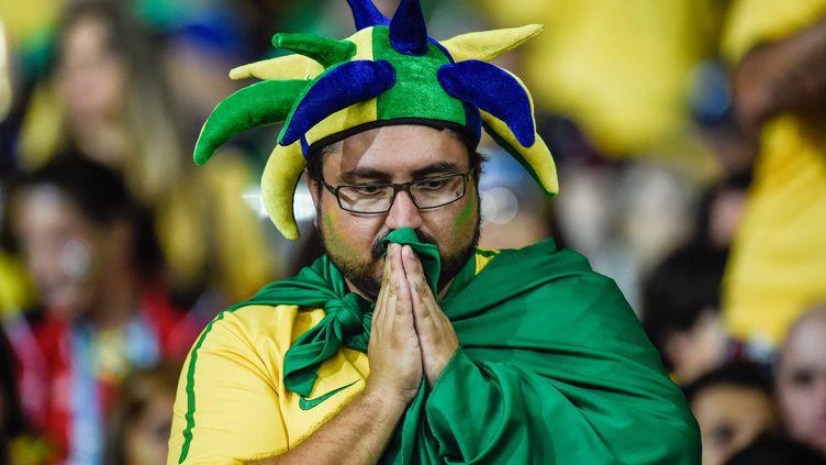 Un supporter de l'équipe du Brésil, le 8 juillet 2014 à Belo Horizonte. (GUSTAVO ANDRADE / AFP)