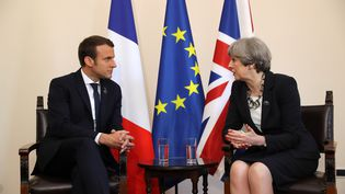 Emmanuel Macron et Theresa May à Taorma (Italie) lors du sommet du G7, vendredi 26 mai 2017. (DAN KITWOOD / AFP)