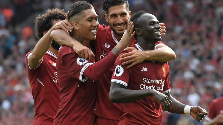 Les Reds de Liverpool dans leur jardin d'Anfield Road. (ANTHONY DEVLIN / AFP)