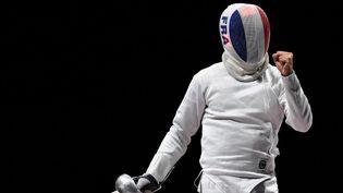 L'épéiste Romain Cannone offre une première médaille d'or à la délégation française. (MOHD RASFAN / AFP)