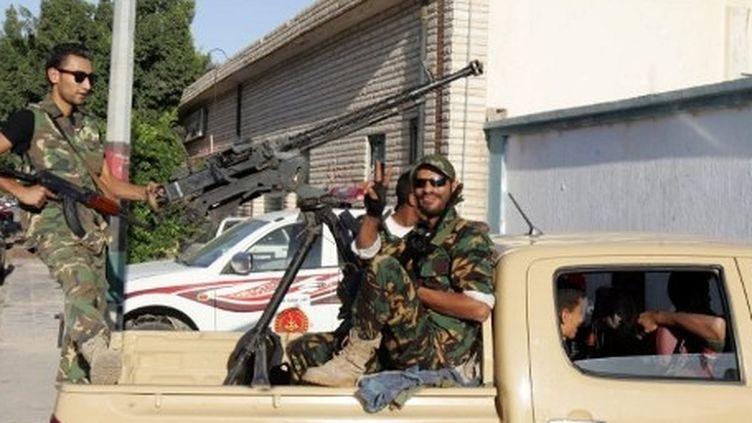 Miliciens libyens lors de la chute de Tripoli, le 22 août 2011. (AFP)