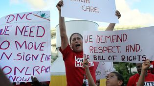 Des manifestants de la fédération syndicale AFL-CIO en Floride en 2007 (JOE RAEDLE / GETTY IMAGES NORTH AMERICA)