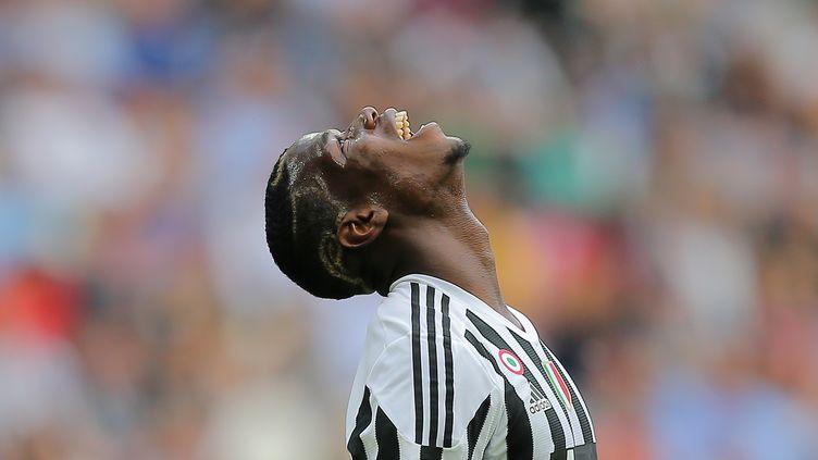 Paul Pogba sera du voyage. (MARCO BERTORELLO / AFP)