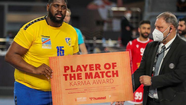 Le pivot de la République Démocratique du Congo, Gauthier Mvumbi, élu joueur du match contre le Bahrein le 19 janvier 2021 au Mondial (MOHAMED ABD EL GHANY / POOL)